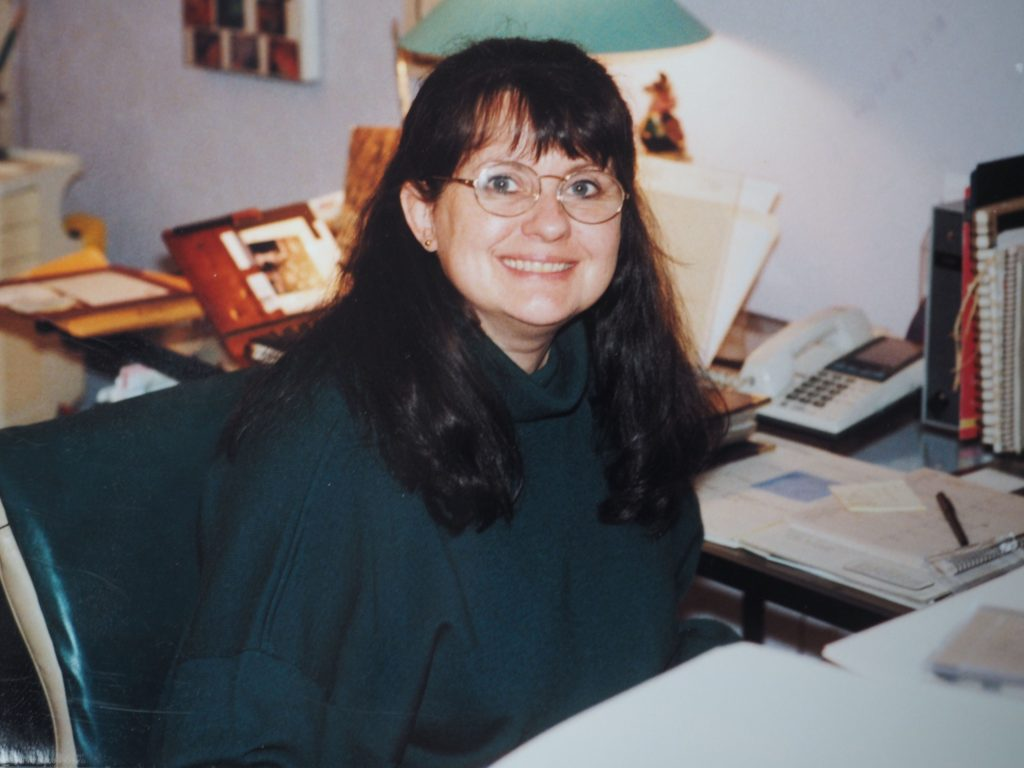 Cindy Sitting at Her Desk